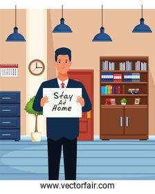 businessman with stay at home covid19 banner