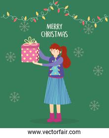 merry christmas woman with ugly sweater holding gift lights decoration