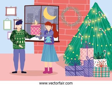 merry christmas couple with gift tree glowing lights room celebration