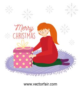 merry christmas young woman on the knees with gift in carpet