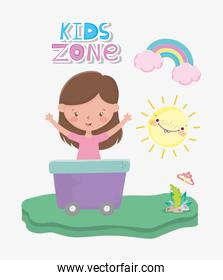kids zone, cute little girl in wagon with rainbow sun and mushroom outdoors