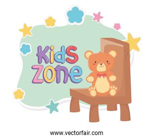 kids zone, teddy bear sitting on chair