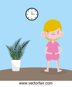 childrens day, little boy with potted plant and clock