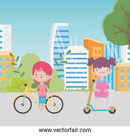 happy childrens day little boy with bike and girl with electric scooter in the street