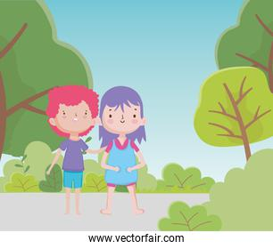 happy childrens day cute little boy and girl in the road park trees