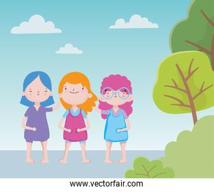 happy childrens day cute little girls standing together trees foliage
