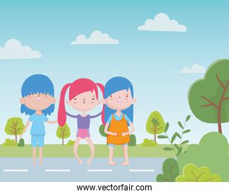 happy childrens day group little boy and girls in the street with trees foliage