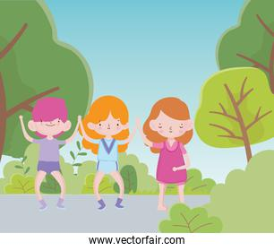 happy childrens day two little girls and boy in the route with trees bush foliage