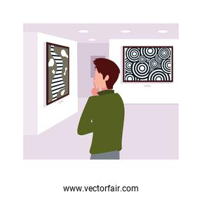 man in contemporary art gallery, exhibition visitors viewing modern abstract paintings