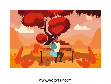 couple of people sitting in park chair , autumn landscape