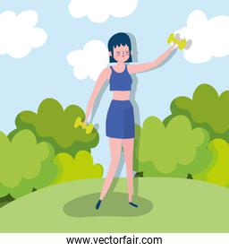 young woman sportswear practicing exercises with dumbbell outdoor healthy life