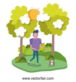 young man walking with dog outdoor healthy life