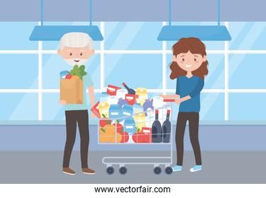 old man with grocery bag and woman with cart full purchase excess