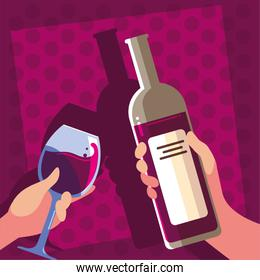 hands holding a bottle and glass of wine