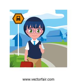 student boy at the bus stop with background city