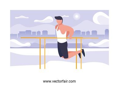 man up hanging on horizontal bar, outdoor or gym sport