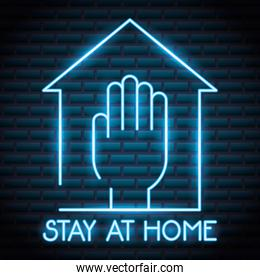 stay at home campaign with hand neon light