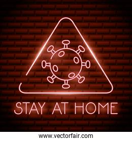 covid19 particle with stay at home neon light triangle