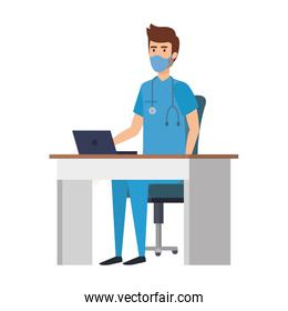 male paramedic with face mask in desk and laptop