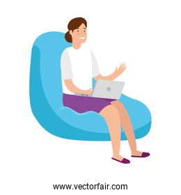 woman sitting in pouf with laptop