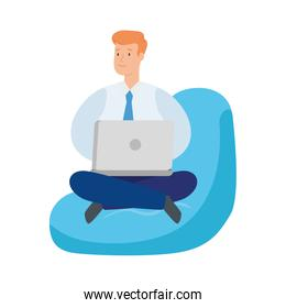 businessman sitting in pouf with laptop