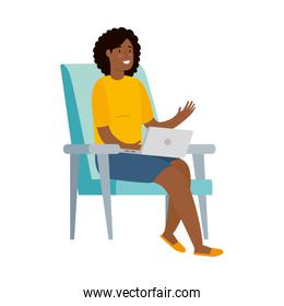 woman afro sitting in chair with laptop isolated icon