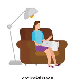 woman sitting in couch with laptop and floor lamp