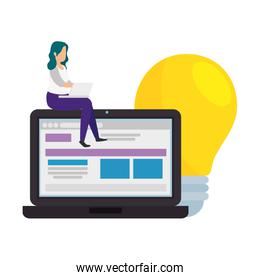 woman with laptop and light bulb