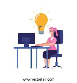 cartoon woman working on office desk with big bulb