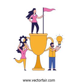 big trophy cup with women and man around