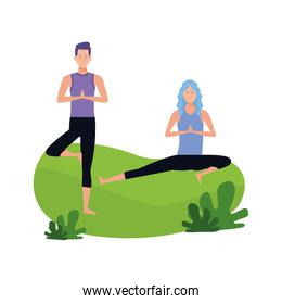 woman and man doing yoga on the grass