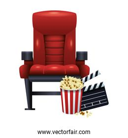 theater chair with pop corn and clapboard