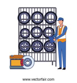 Car mechanic with tires rack over white background