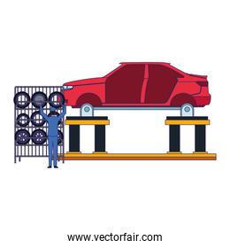 mechanic at rack of tires and lift with body car