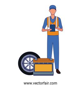 mechanic standing with battery and car tire