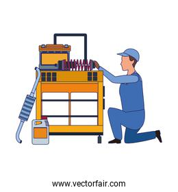 mechanic kneeling at tools trolley, colorful design