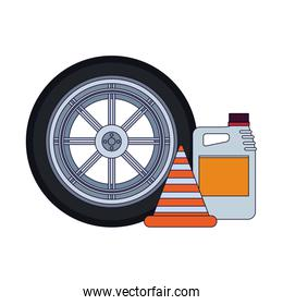 car tire with traffic cone and oil bottle
