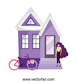 eco friendly transport, young woman bicycle outside house