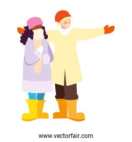 couple of people standing with winter clothes on white background