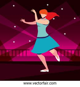 young woman dancing in nightclub