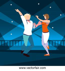couple of people dancing in nightclub