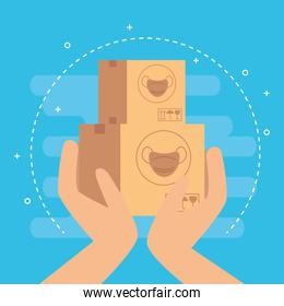 hands with boxes of face masks