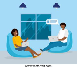 couple afro working in telecommuting sitting in pouf