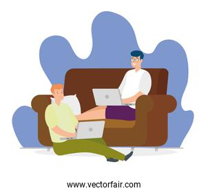 men sitting in couch and floor with laptops