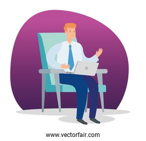 businessman sitting in chair with laptop