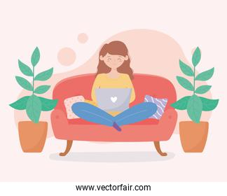 quarantine stay at home, woman with laptop on sofa with potted plants