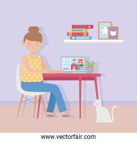 meeting online, woman working laptop in desk with cat in home