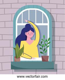 stay home quarantine, woman looking at the window with plant in pot, facade of the brick building