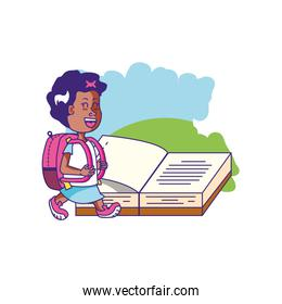 cute little student girl with book open