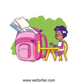 cute student girl in desk with school bag
